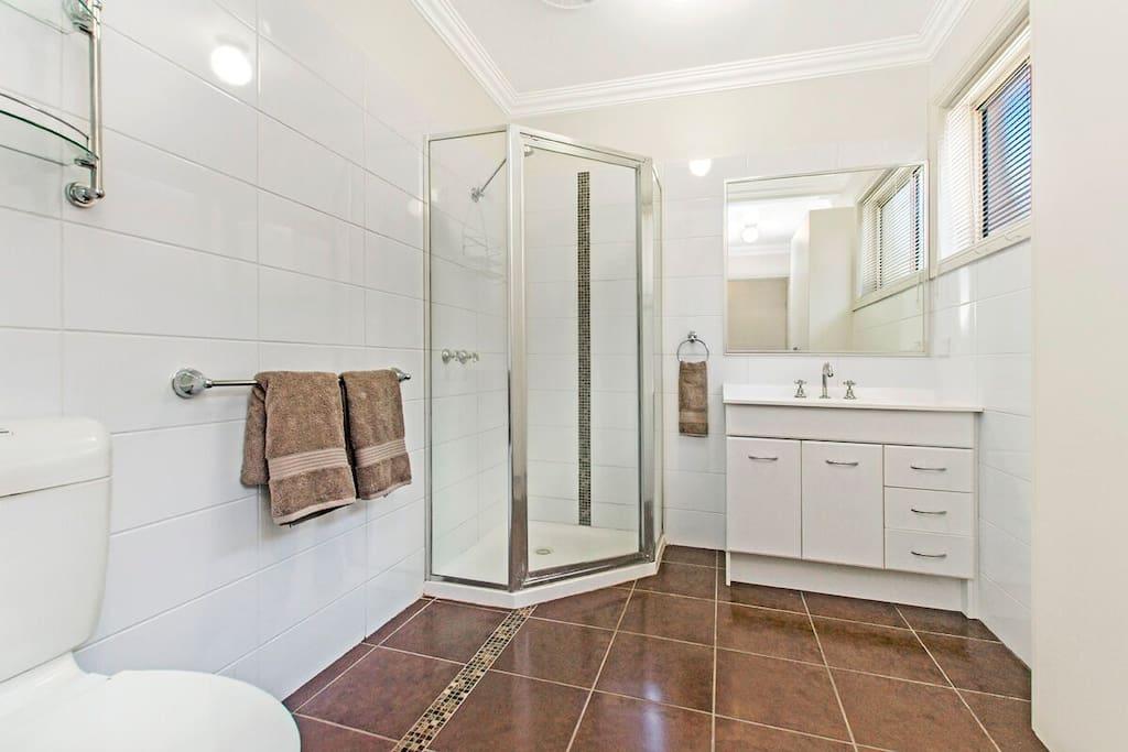 Spacious bathroom with laundry.