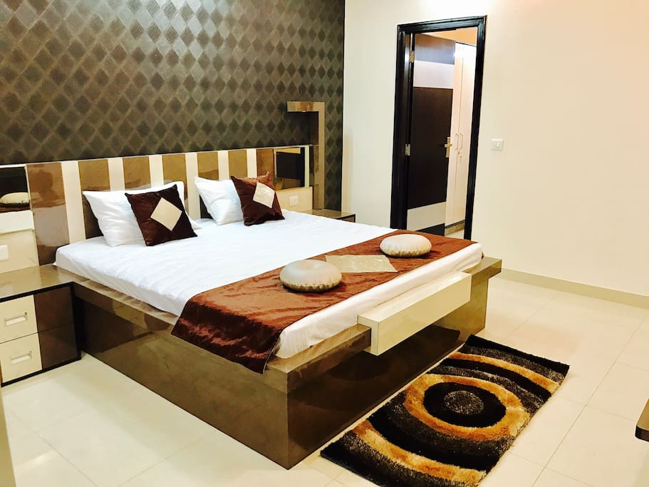 Designer King Bed and attached modern bathroom plus wardrobe