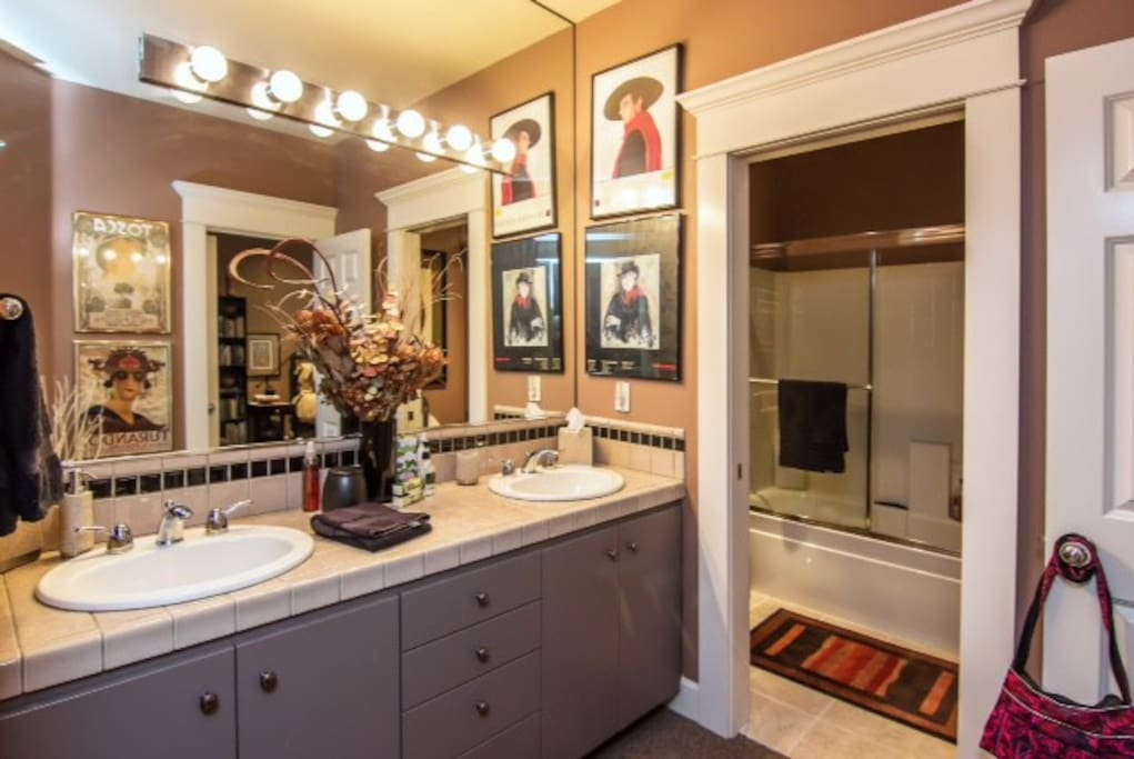 Bath with double vanity and shower/tub/toilet in separate space
