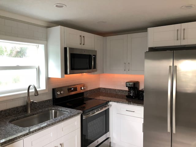 Brand new, full size kitchen with stainless steel appliances make preparing meals a pleasure.