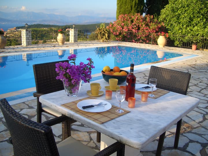 Villa Bacchus, a traditional-style Greek country cottage with a sea view swimming pool.