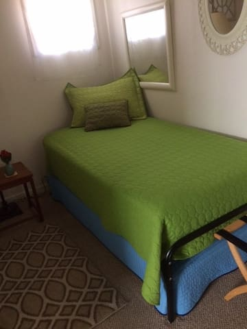 The smaller bedroom has a single trundle bed.