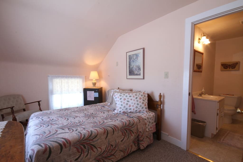 3rd floor room with double bed and private bath
