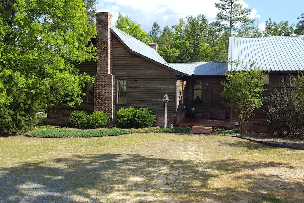 The home is nestled into the woodline by the 3 acre stocked pond.