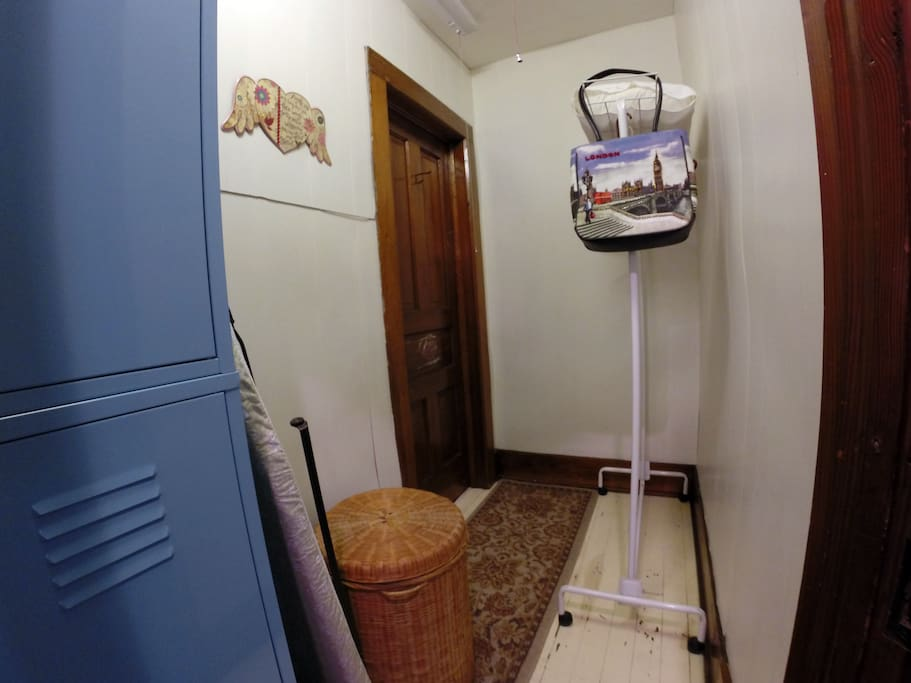 Roomy closet with iron and ironing board, beach towels and a locker with key for personal items.