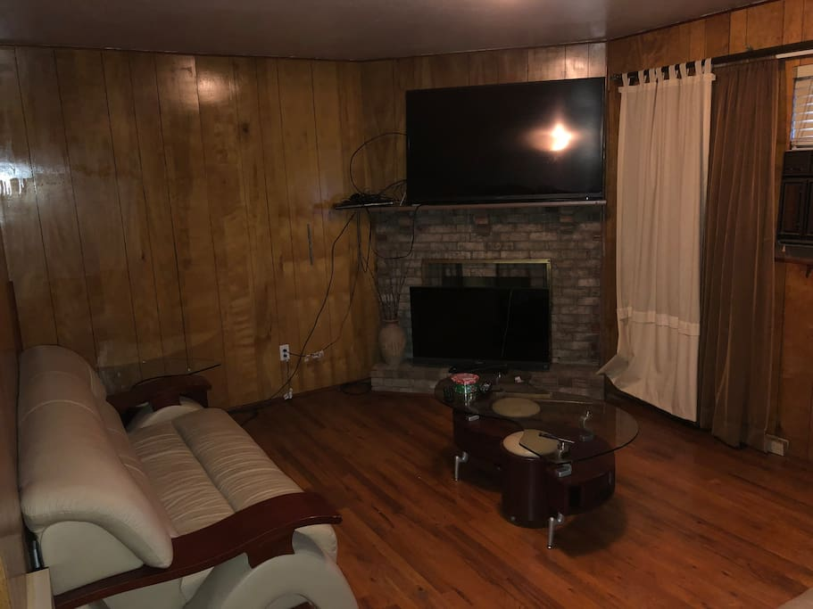 Den w/ Fireplace and 60 inch flatscreen tv