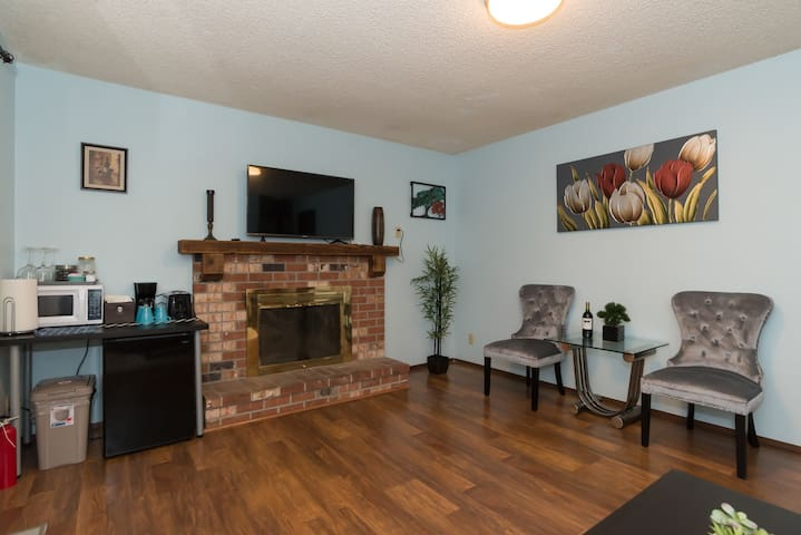 Living room features a lovely fireplace and HDTV