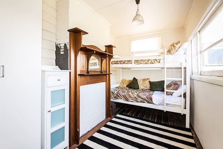 Third bedroom with bunks for children. Room includes pedestal fan.