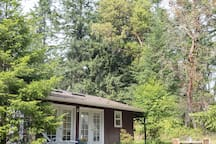 Room for kiddos to play while you sip Vashon wine on the porch with the wraparound deck and three sets of French doors.