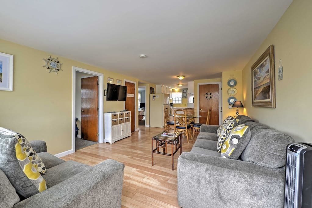 Step into the living area which has a sofa, love seat, and flat-screen cable TV.
