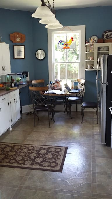 Kitchen with homemade stained glass rooster from Key West...