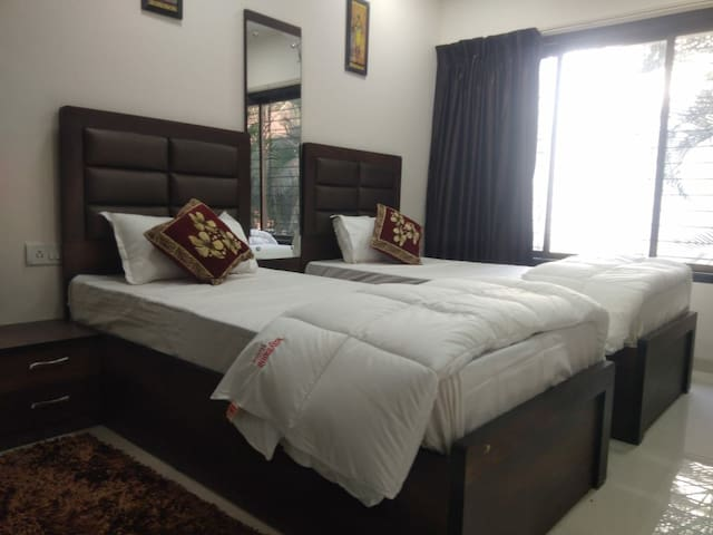 An Elegant, Clean And Airy Room Near Airport Pune.