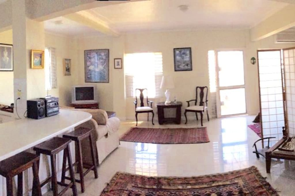 Another view of open floor plan leading to patio.