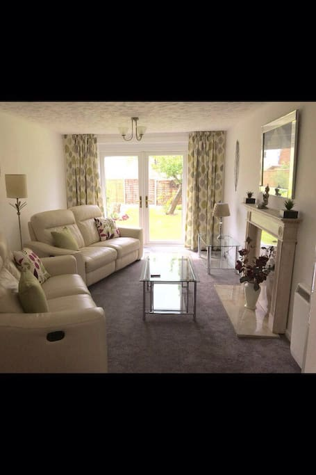 Ground floor, with french doors leading into the communal gardens. The living room has TV, DVD player and Wifi. Dining table with 4 chairs.
