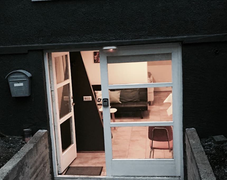 The entrance to the apartment is behind the house, not visable from the street.