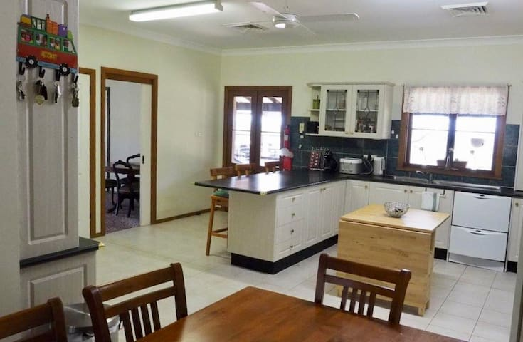 The spacious kitchen has a 10 seat dining table, gas cooker, dish-washing machine, microwave oven and fridge.