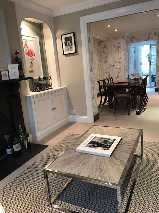 Sitting room through to dining room and private garden
