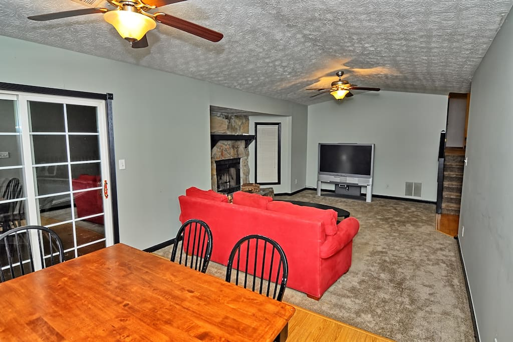 Living room area with TV and Sofa; dinning area