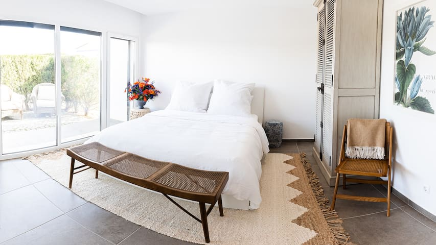 The Garden Bedroom on the main floor has a King Bed, ensuite bath, TV, private entrance and patio, and personal kitchenette.