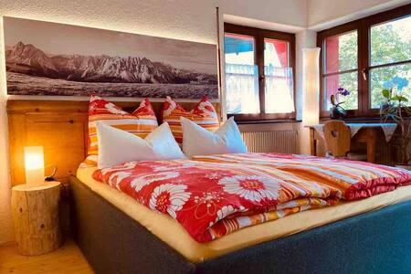 Camera doppia luminosa con balcone