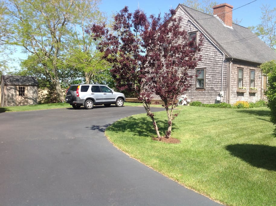 Side picture with large driveway for lots of parking