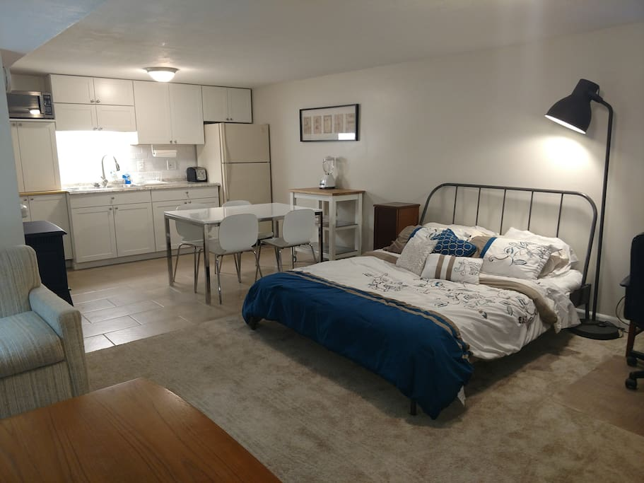 Queen size bed and kitchenette
