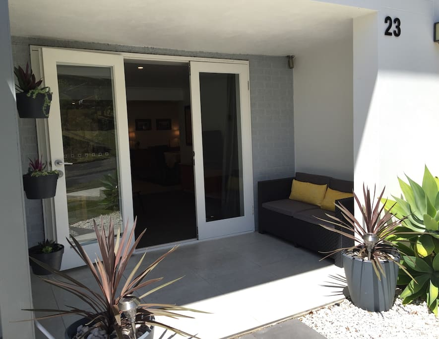 The main entrance to the apartment with space to relax outside in the shade.