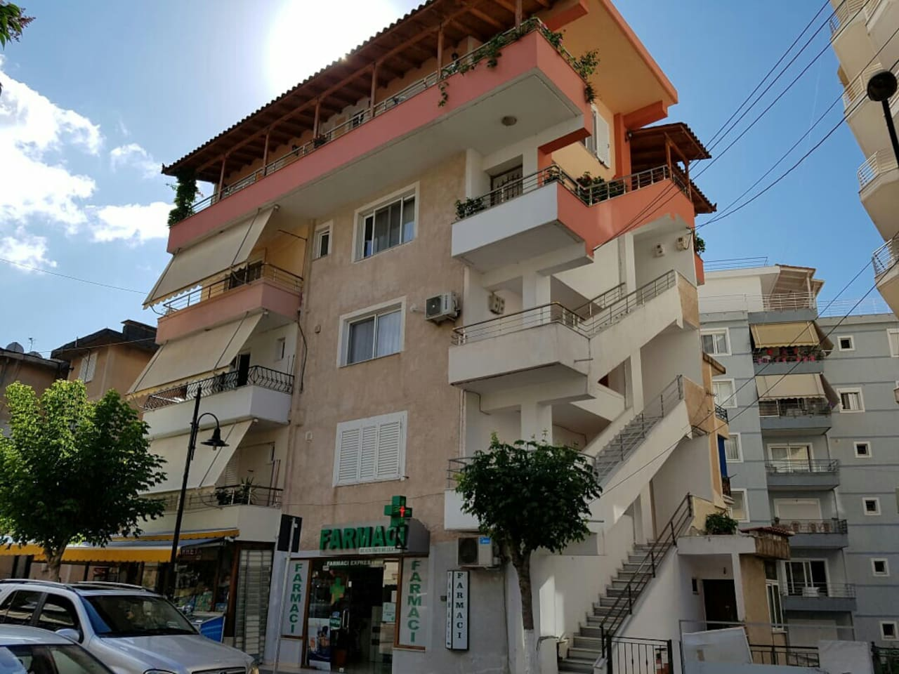 This is the entrance to the apartment. The apartment is on the third floor where the air conditioner is in the picture. Please note that in Albania we count from the ground floor. So the ground floor is the same as the first floor.