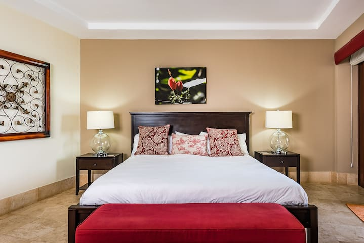This master bedroom contains a king sized bed.