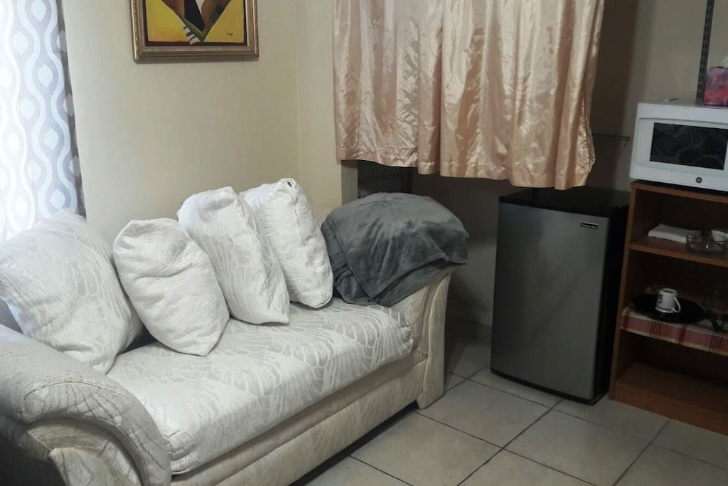 There is a closet with drawers iron and iron board for you to be prepared for every occasion. Feature curtains and privacy blinds. This room has a coffee maker, microwave and mini fridge for you to use and have a more comfortable stay.