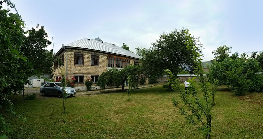 House in Gabala with a large yard, near the center