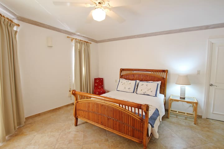Third bedroom with a queen bed, a/c and ceiling fan