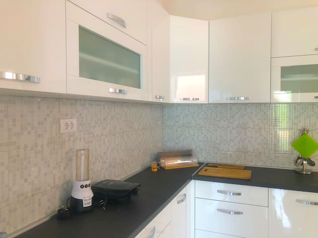 Kitchen with full amenities.