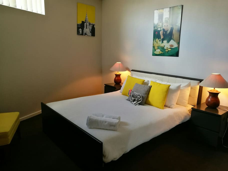The Master Room features a super comfy Queen bed, private ensuite bathroom, built-in wardrobe and floor to ceiling mirrors.