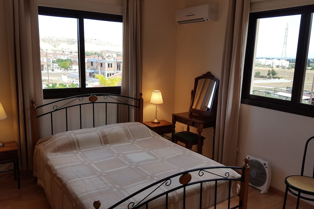 Roomy en suite with King size bed, ample storage. Views over fields to sea and hills.