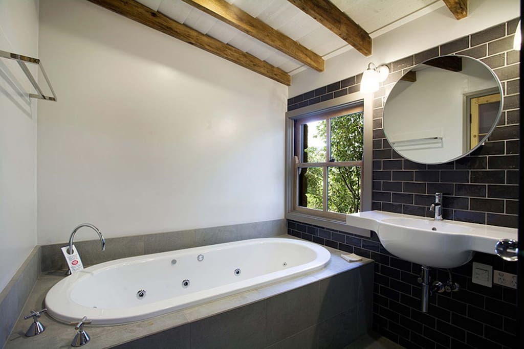 Ensuite bathroom provides an elegant claw-foot bath, rain shower, vanity and toilet.  No cold feet, enjoy the luxury of heated floors