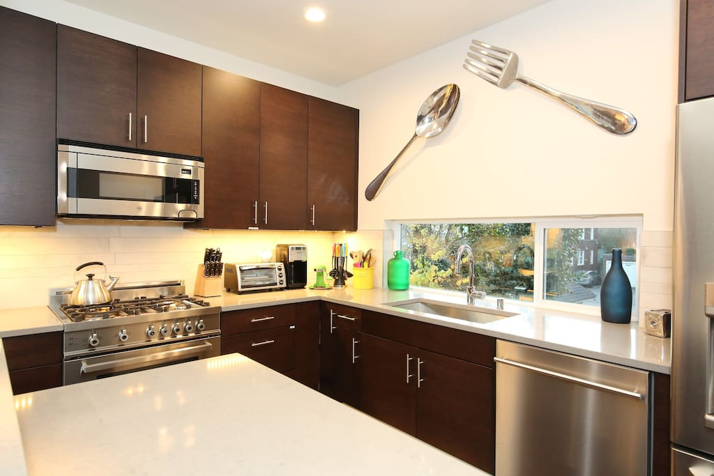 full stainless kitchen with gas stove