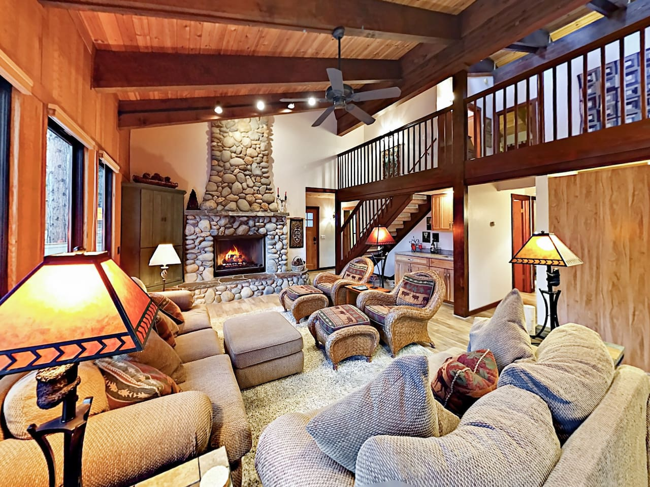 Welcome to Northstar! The living room has a warm mountain-lodge feel and a gas fireplace.