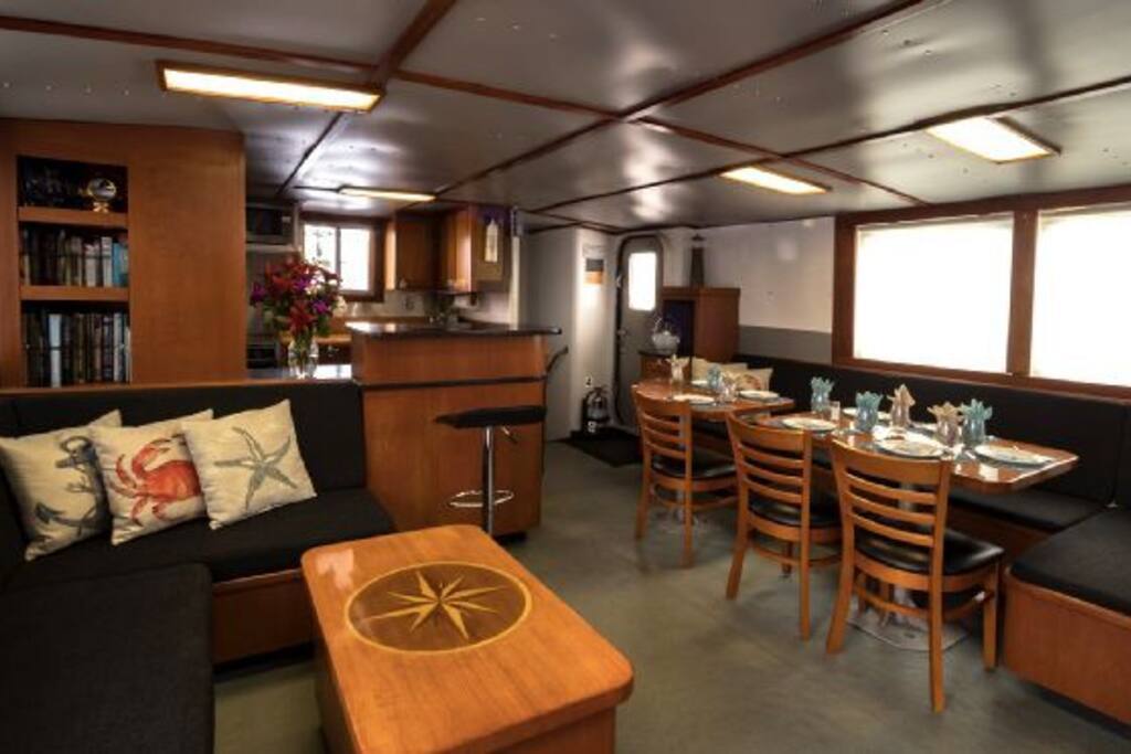 View of the cozy corner with coffee table, galley and salon from the starboard side door looking aft.