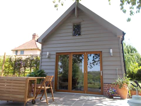 Beautiful converted barn in tranquil garden