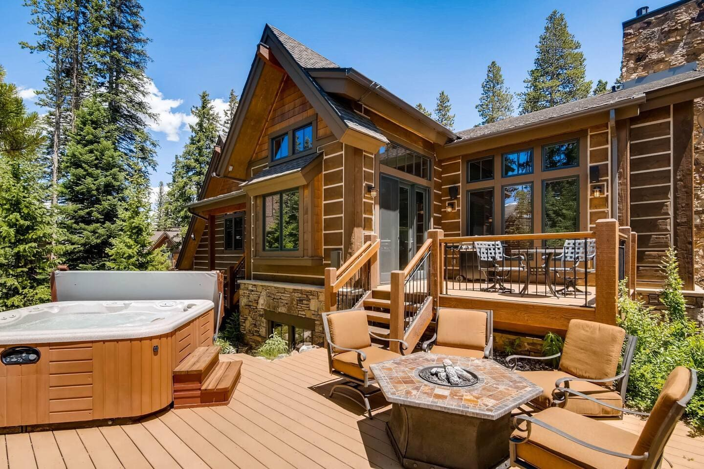 Welcoming and inviting mountain elegance outdoor area and hot tub