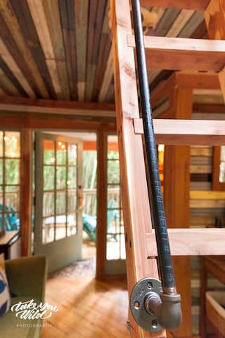 Lindsay Appel's gorgeous shot inside the treehouse.  Our cedar ladder can be removed for wedding or video shoots and folds backwards to unfurl the queen sized sofa bed.