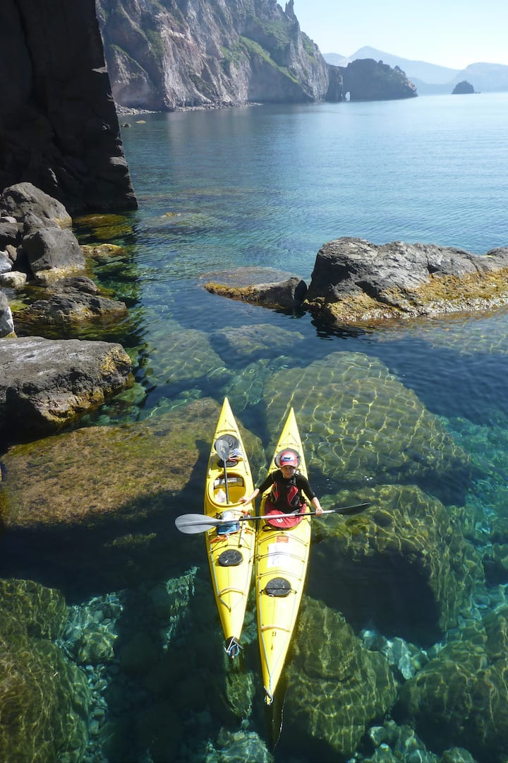 paddling through crystal clear water