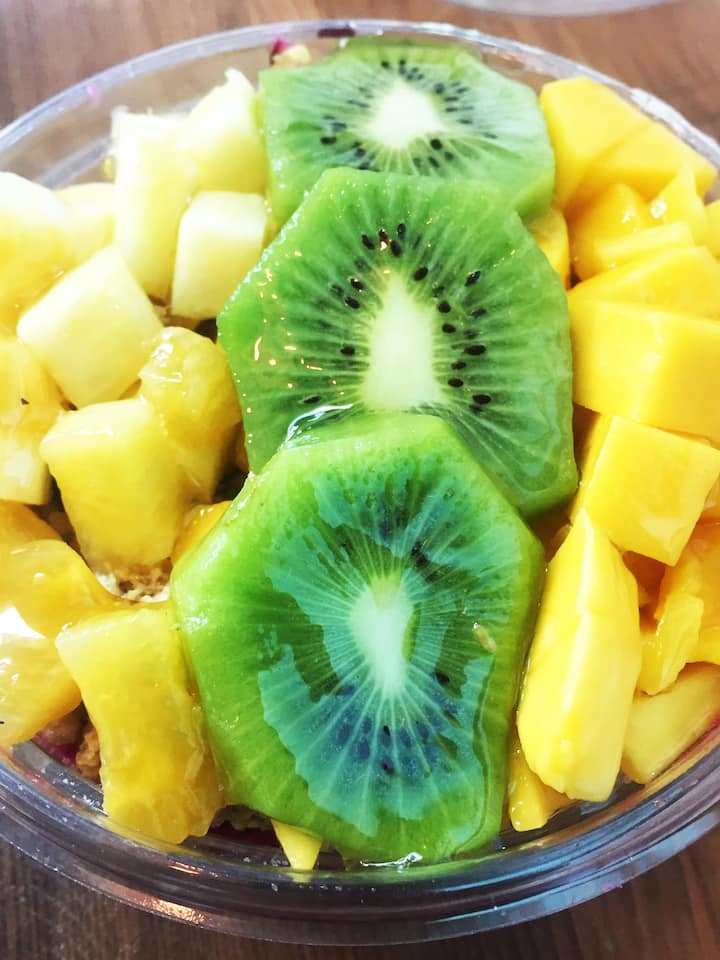 Pitaya Electric Fruit Power Bowl topped with Mango, Pineapple, and Kiwi