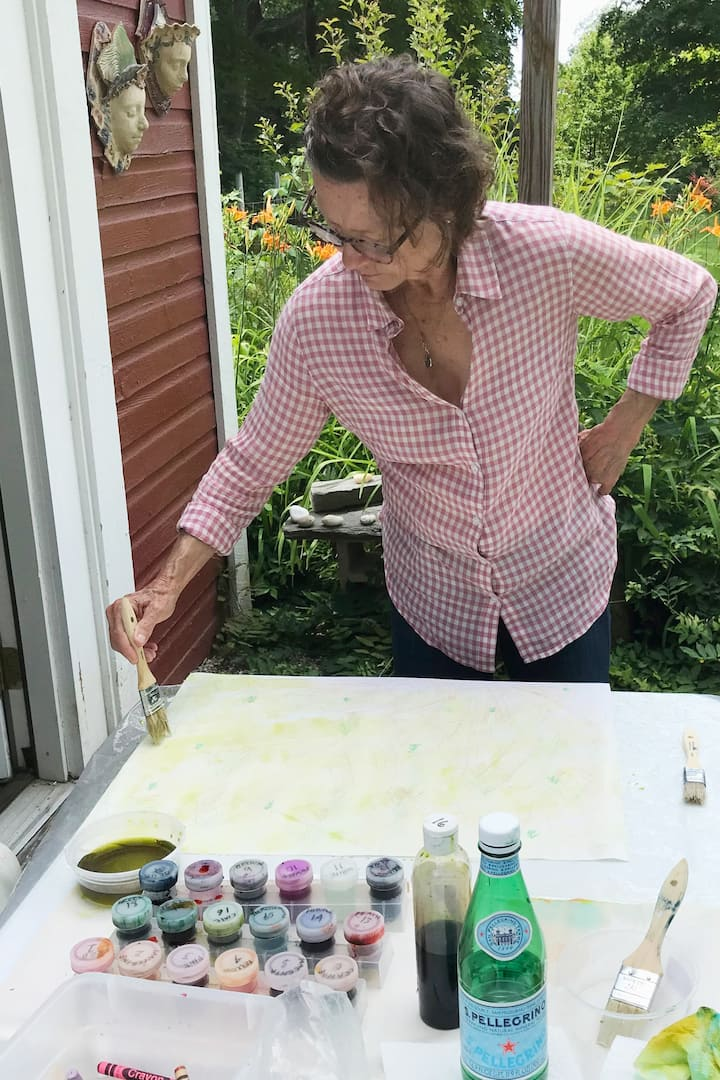 Painting a water color wash over crayon