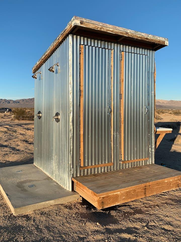 Flushable toilet, outdoor shower + sink