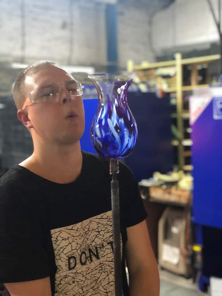 A glassblower finishing his vase