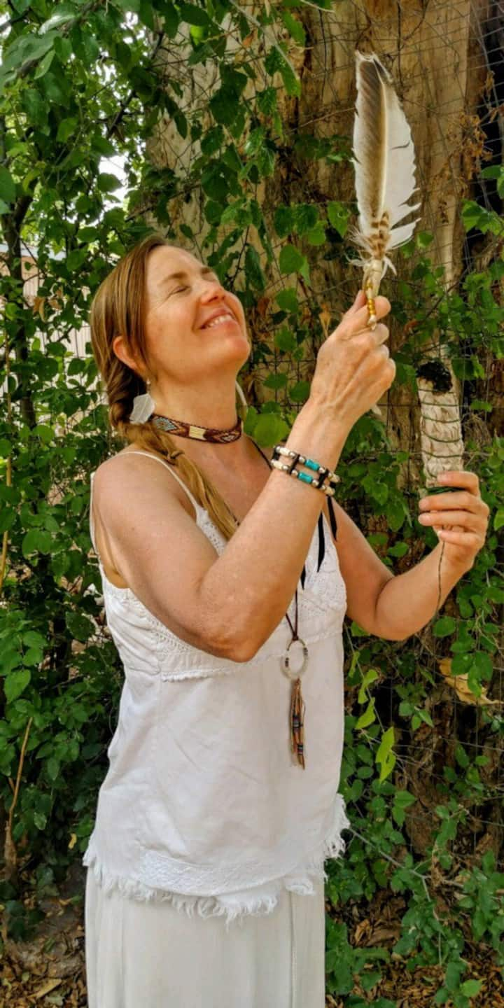Robin smudging with sage