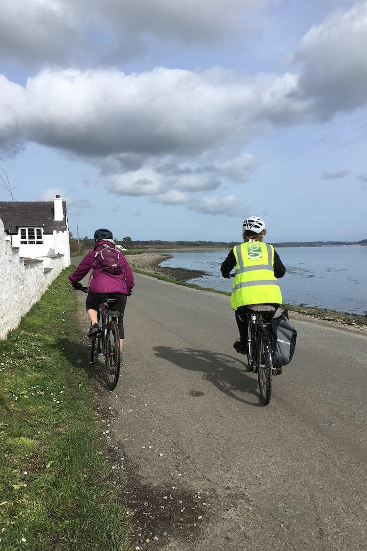 Cycling along the Menai Strait.