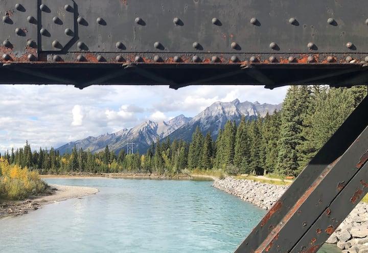 a train trestle across the Bow River
